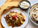 Citrus-Marinated Pulled Pork Tacos with Sauteed Apples, Onions and Cheddar